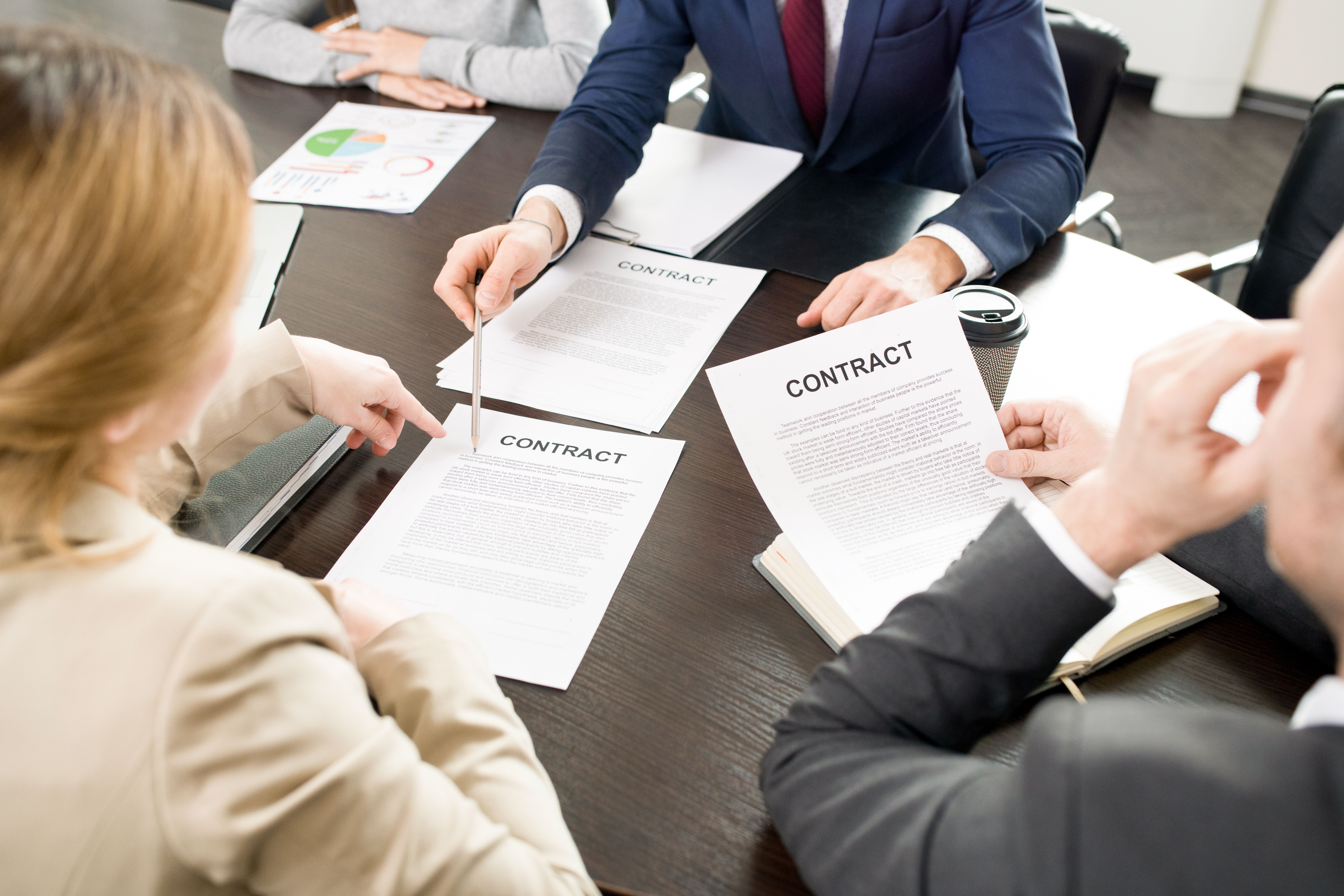 A male agency is explaining to a couple about a fixed lease agreement or periodic agreement.JPG