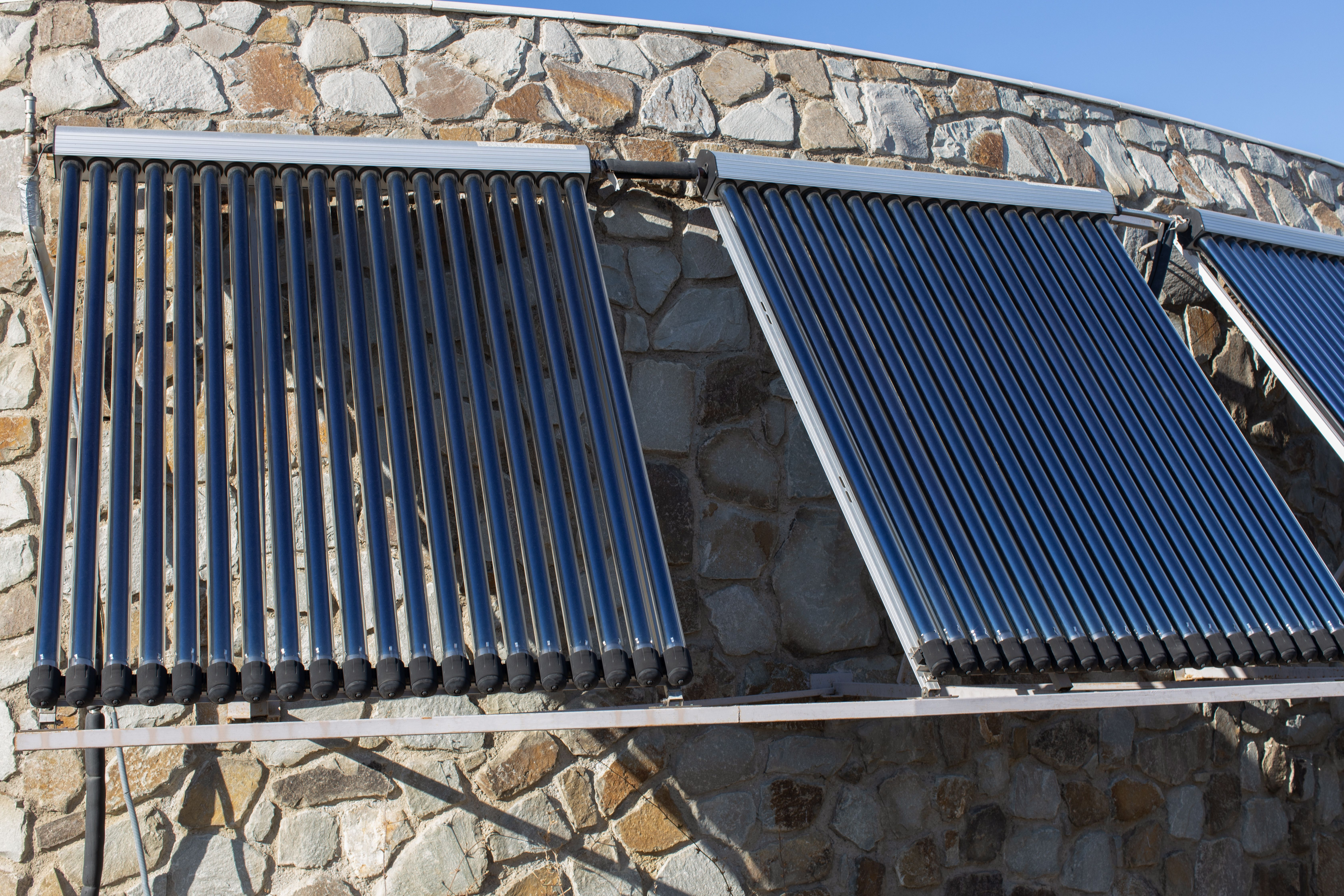 Solar water heating system installed on the roof of a house