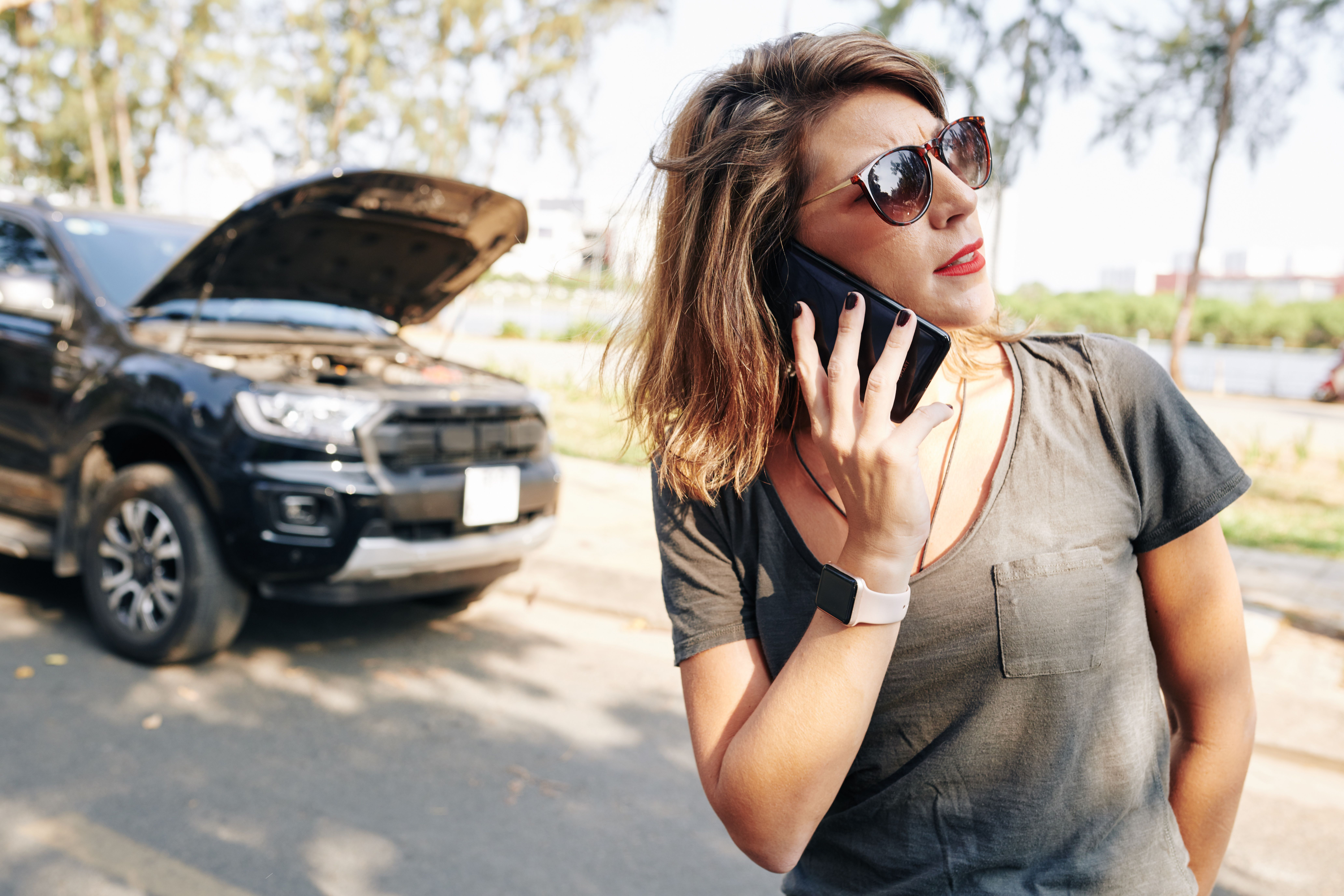 A woman on the phone after car breakdown