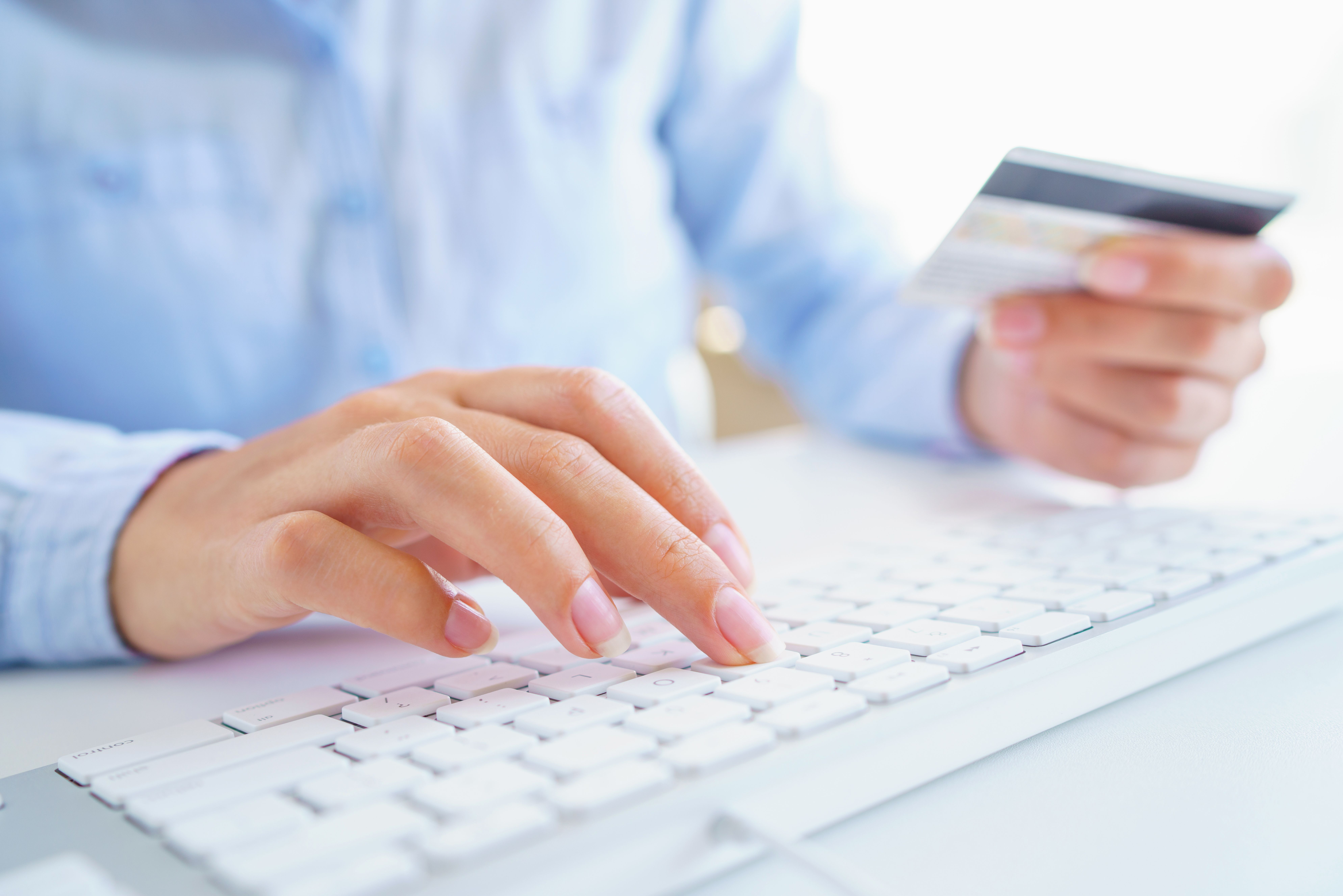 A woman using a credit card for online payments