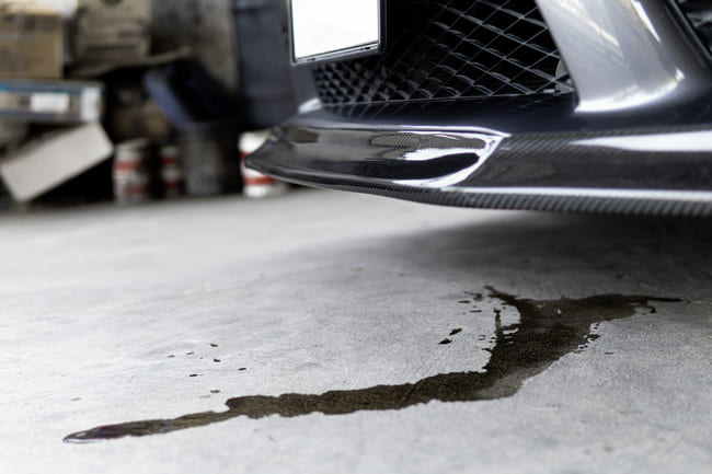 What are the signs of oil cooler failure