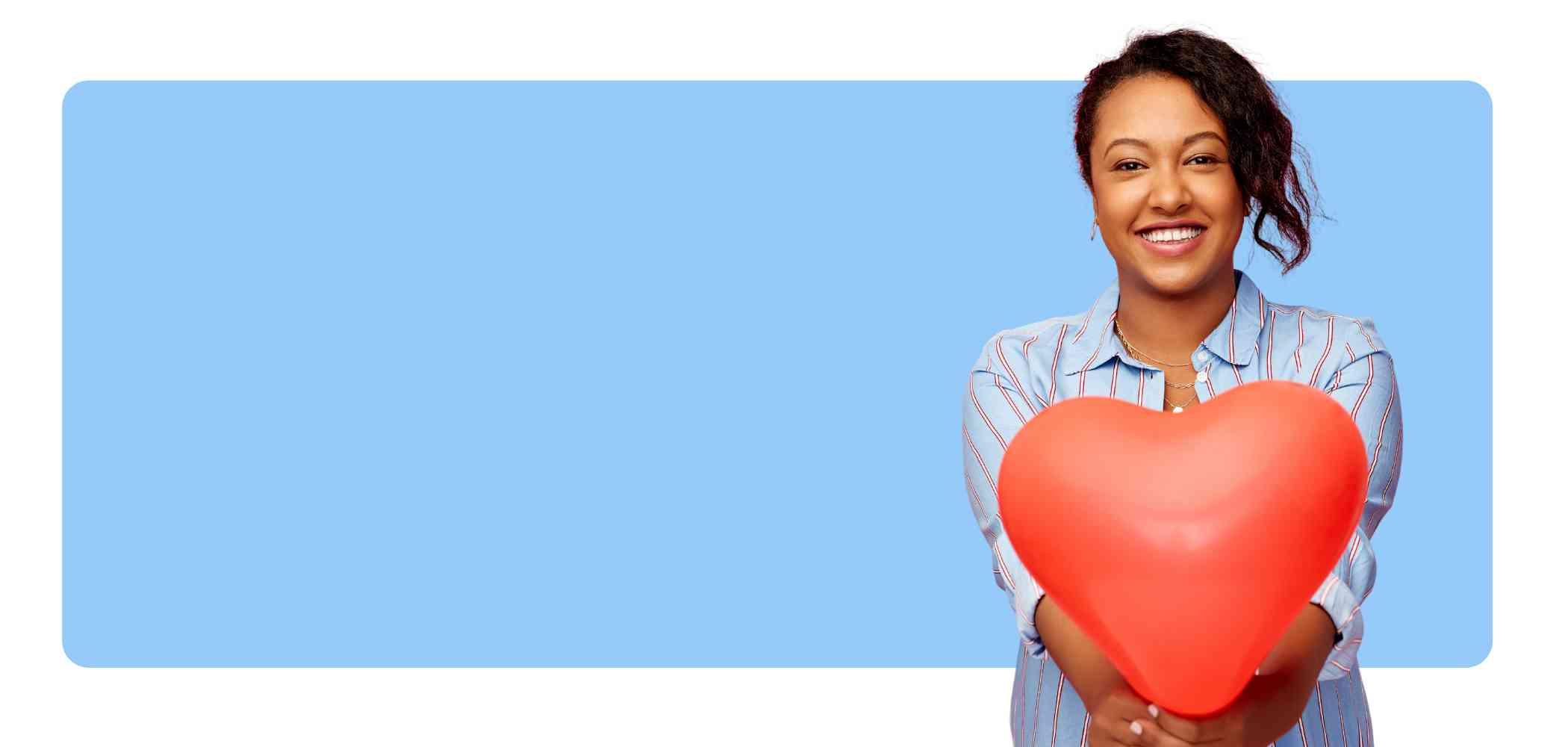 girl holding heart balloon