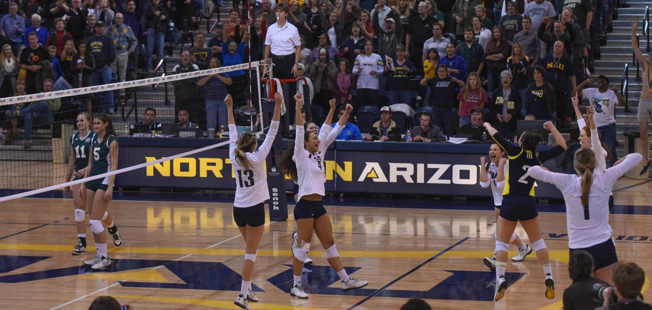 sportswomen cheering a win