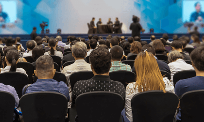 Audience watching a conference