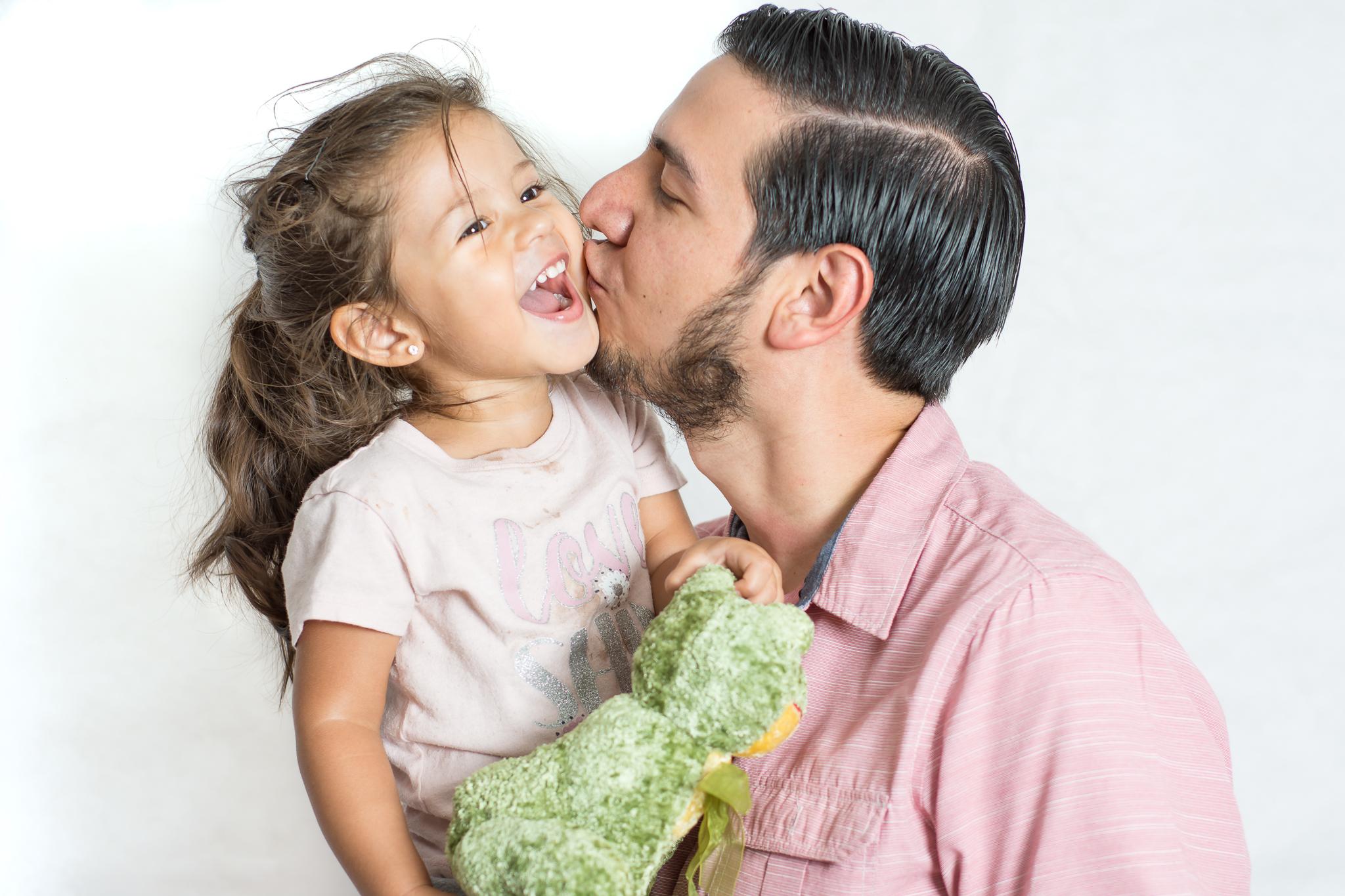 Javier kissing his daughter.