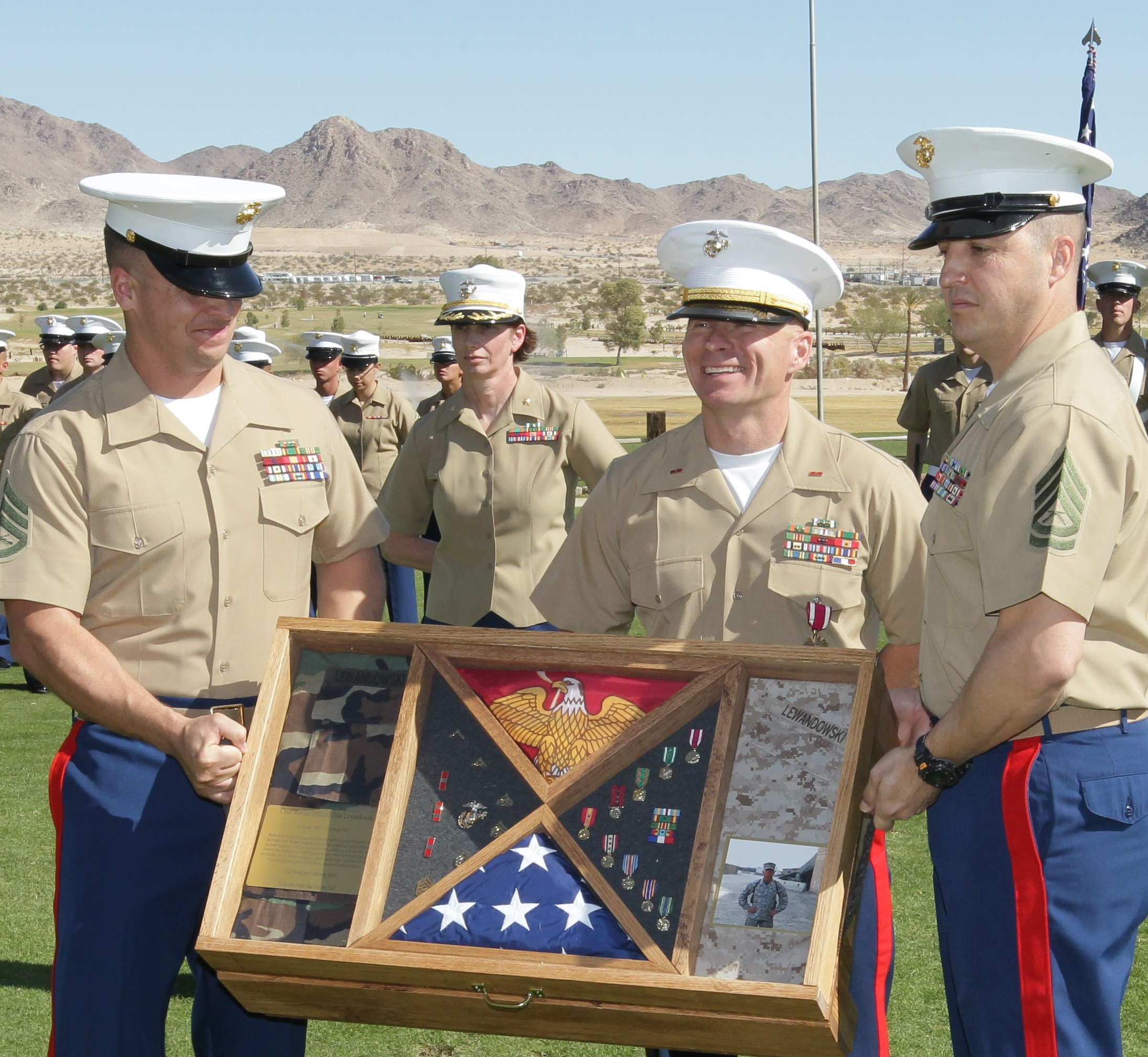 John posing with his fellow Marines.
