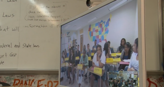 Students use TelePresence to connect for their weekly Digital Civil Rights class.