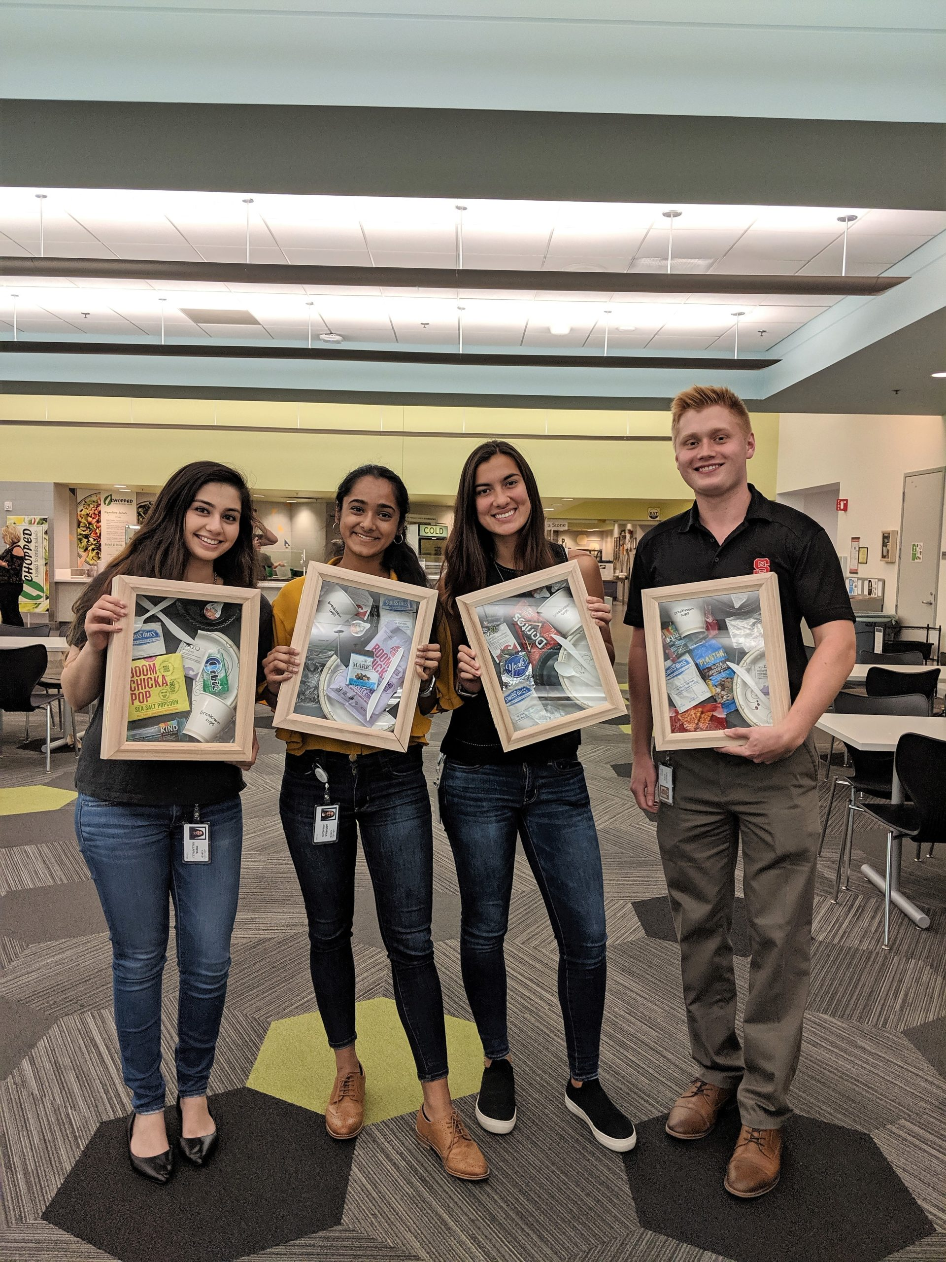 Interns in RTP help put together shadowboxes to show employees how to correctly sort waste