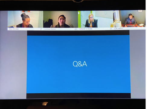 the key is trust and accountability as you embrace remote working | Stand up virtual meeting with four attendees and a powerpoint with Q & A written on a blue screen