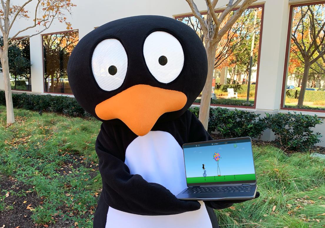 JiJi, ST Math's mascot, holding a laptop