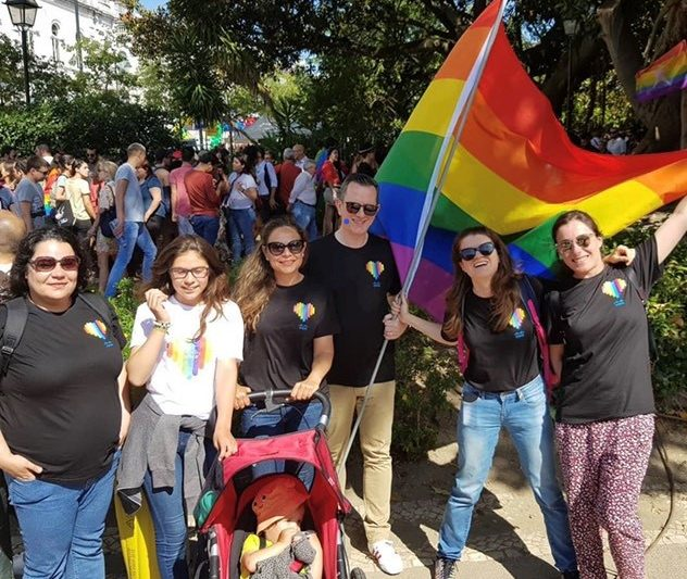 Mariya holds the Pride flag at the Portugal PRIDE parade with fellow members of the Cisco Pride Employee Resource Organization.
