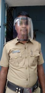 A police officer wearing one of Vispala's 3D printed face shields