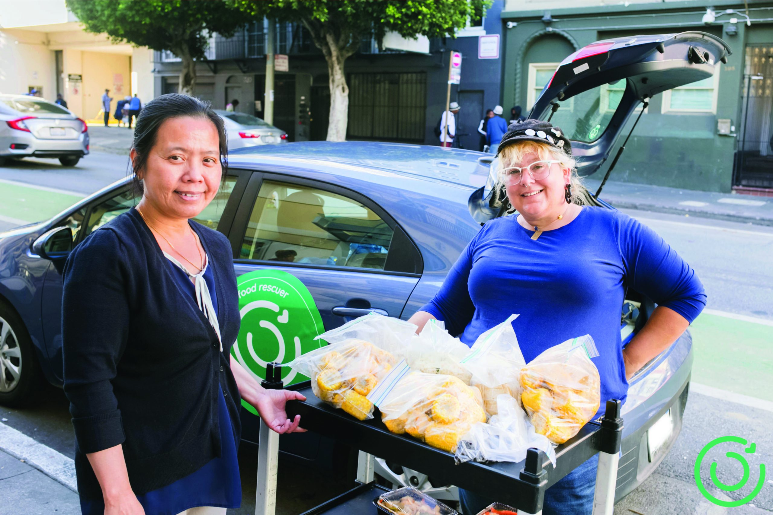Food rescuers drop off donated food to a senior center