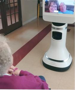 Happy couple visiting grandmother via Ava Robotics