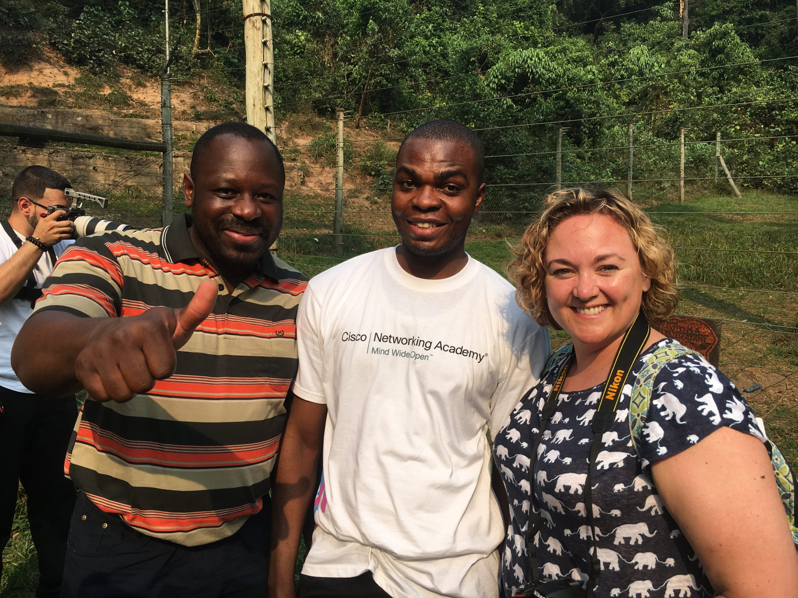 Shawn and her peer Calvain Nangue smiling with one of the Network Academy students in the Congo.