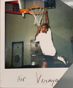 Vinaya dunking a basketball as a child.