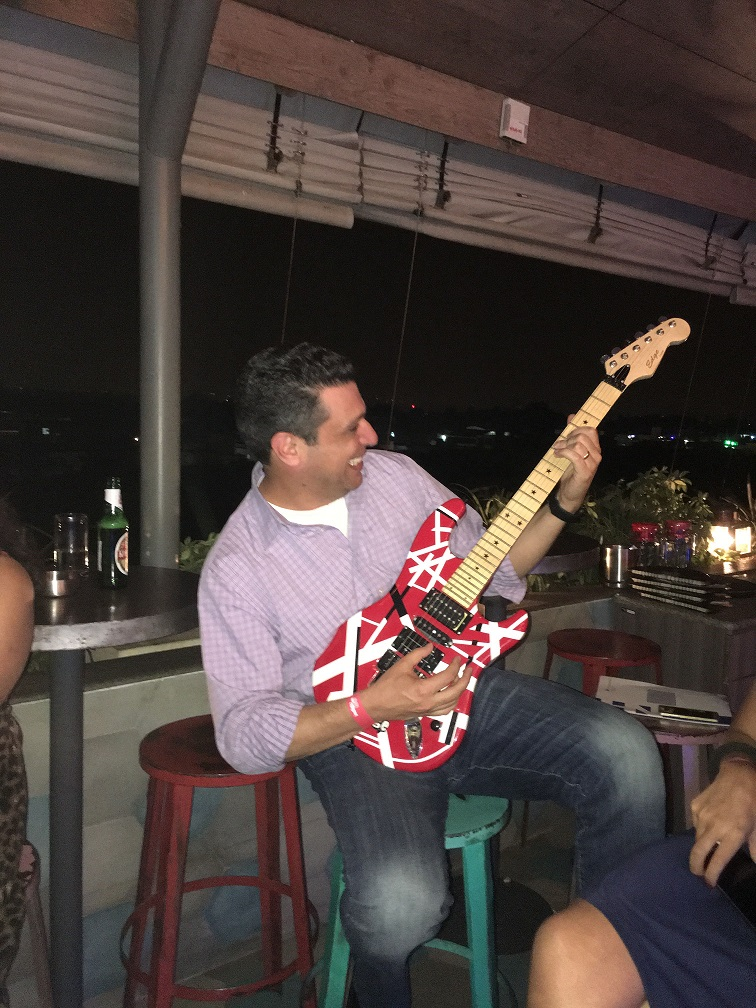 Joey playing electric guitar.