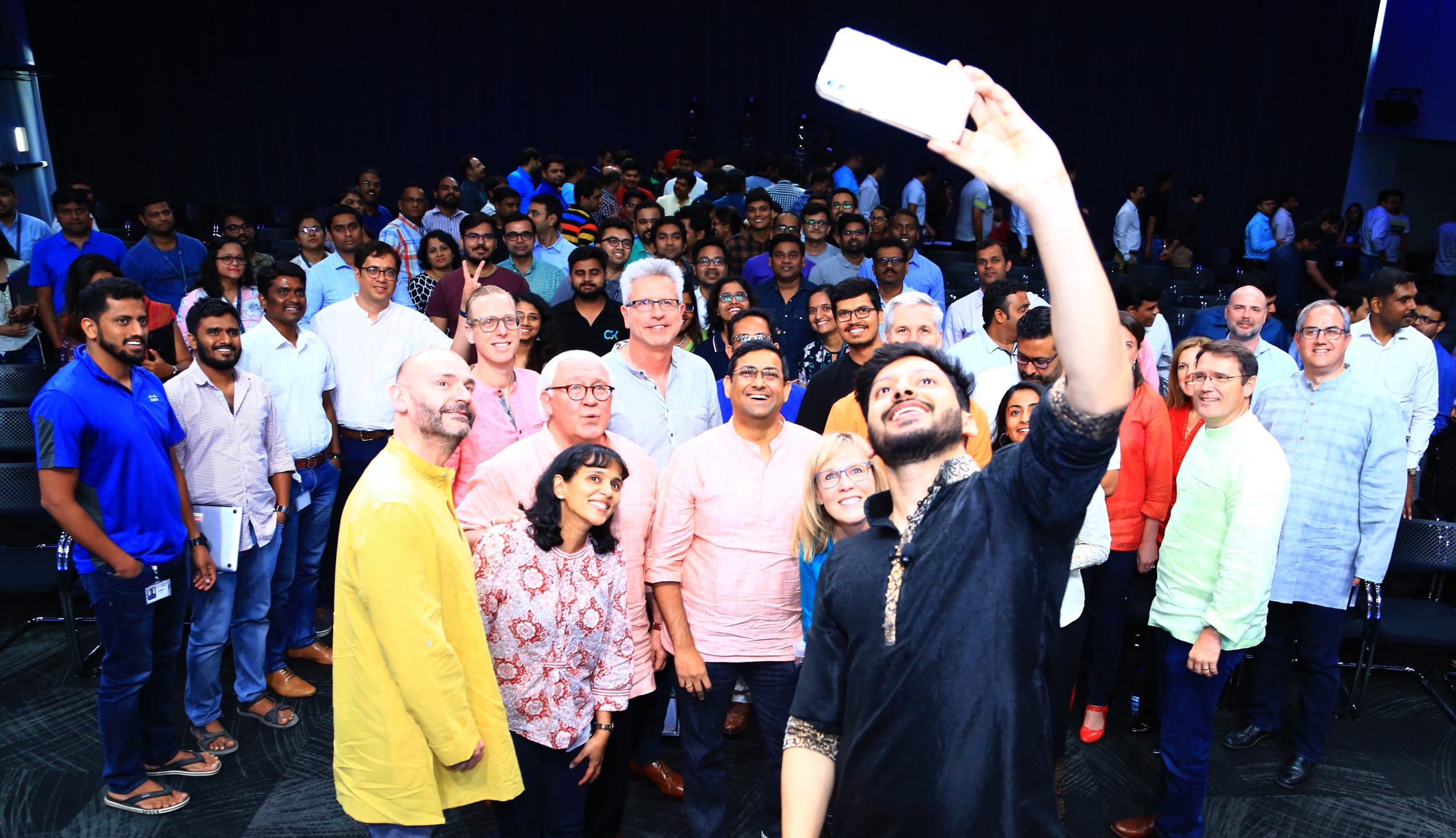 Rahul taking a selfie with a large group of people.