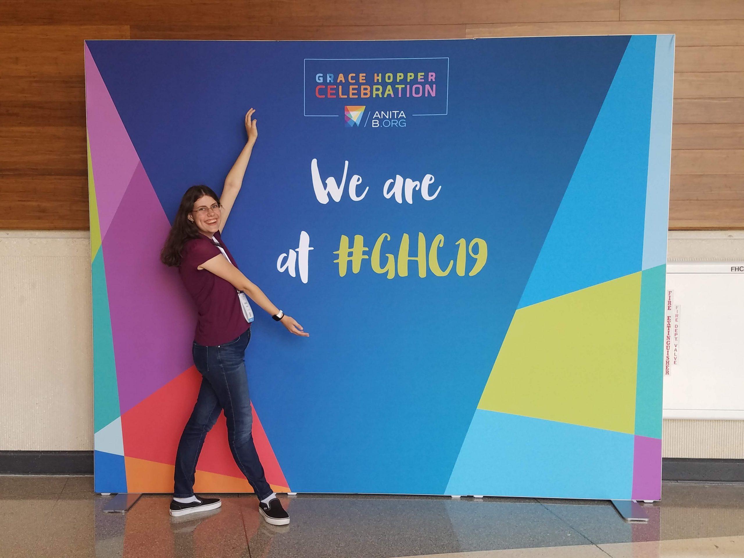 Chloe in front of Grace Hopper sign.