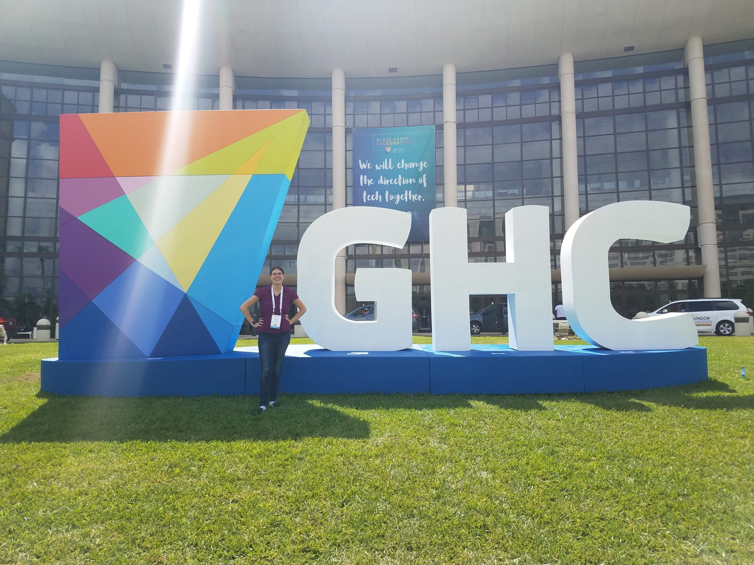 Chloe in front of the GHC sign.