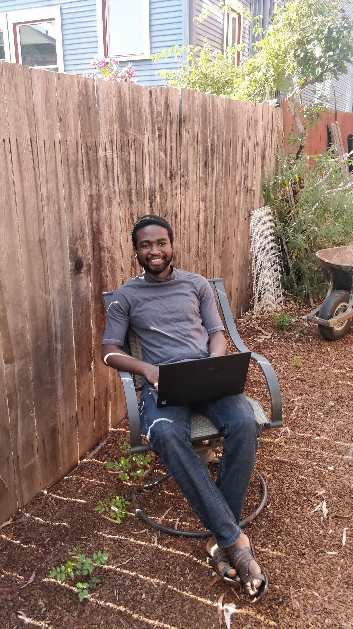 Faith sitting in backyard.