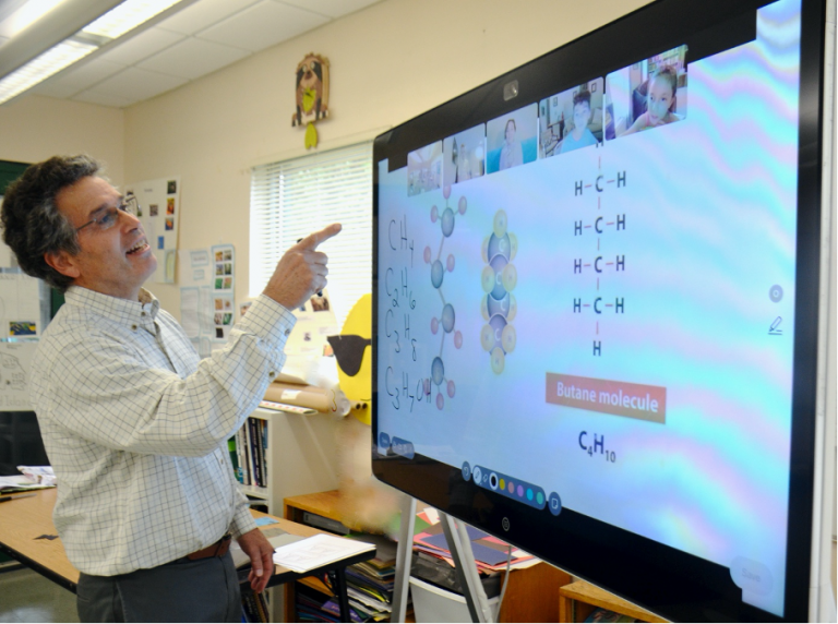 Headmaster at Oak Meadow using Webex board