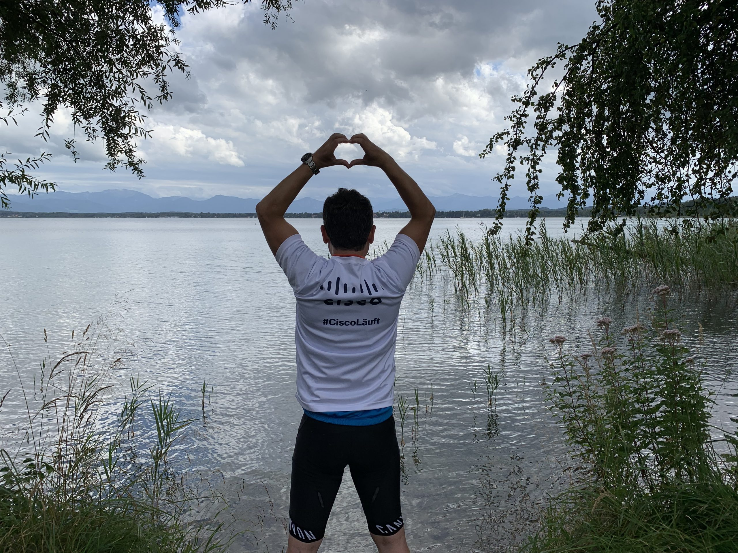 Ahmet in front of water in his Cisco Lauft shirt