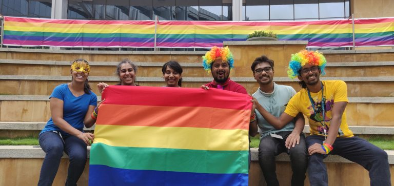 People holding a PRIDE flag