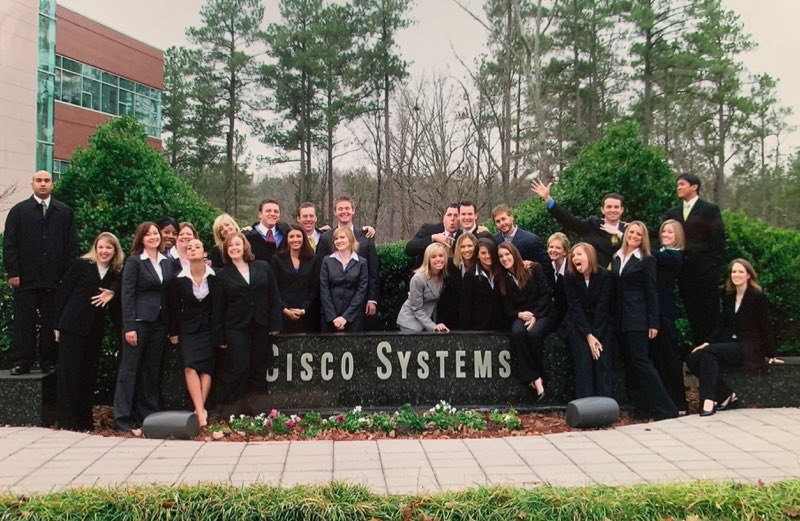 Ritchie and co-workers in front of Cisco sign.