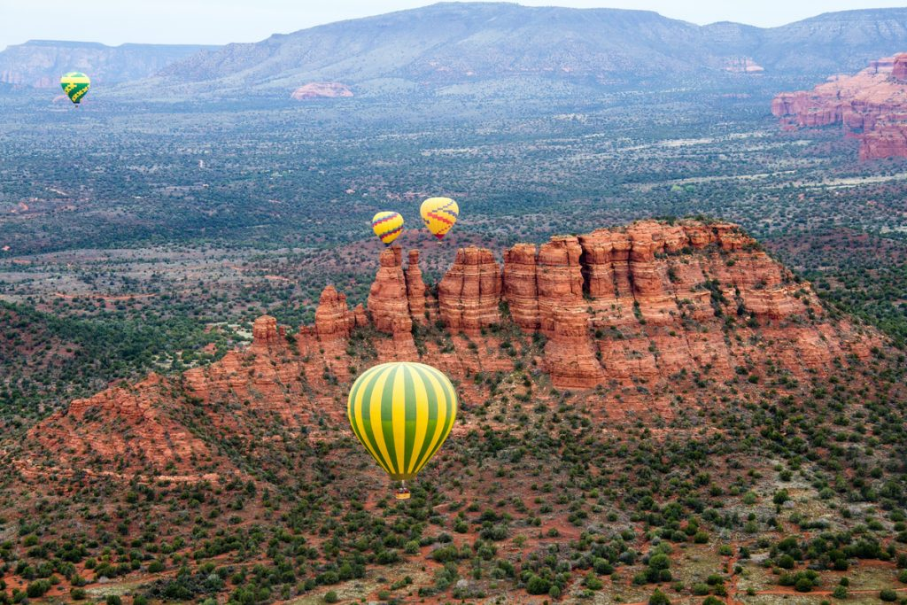 Hot Air Balloons over Red Landscape