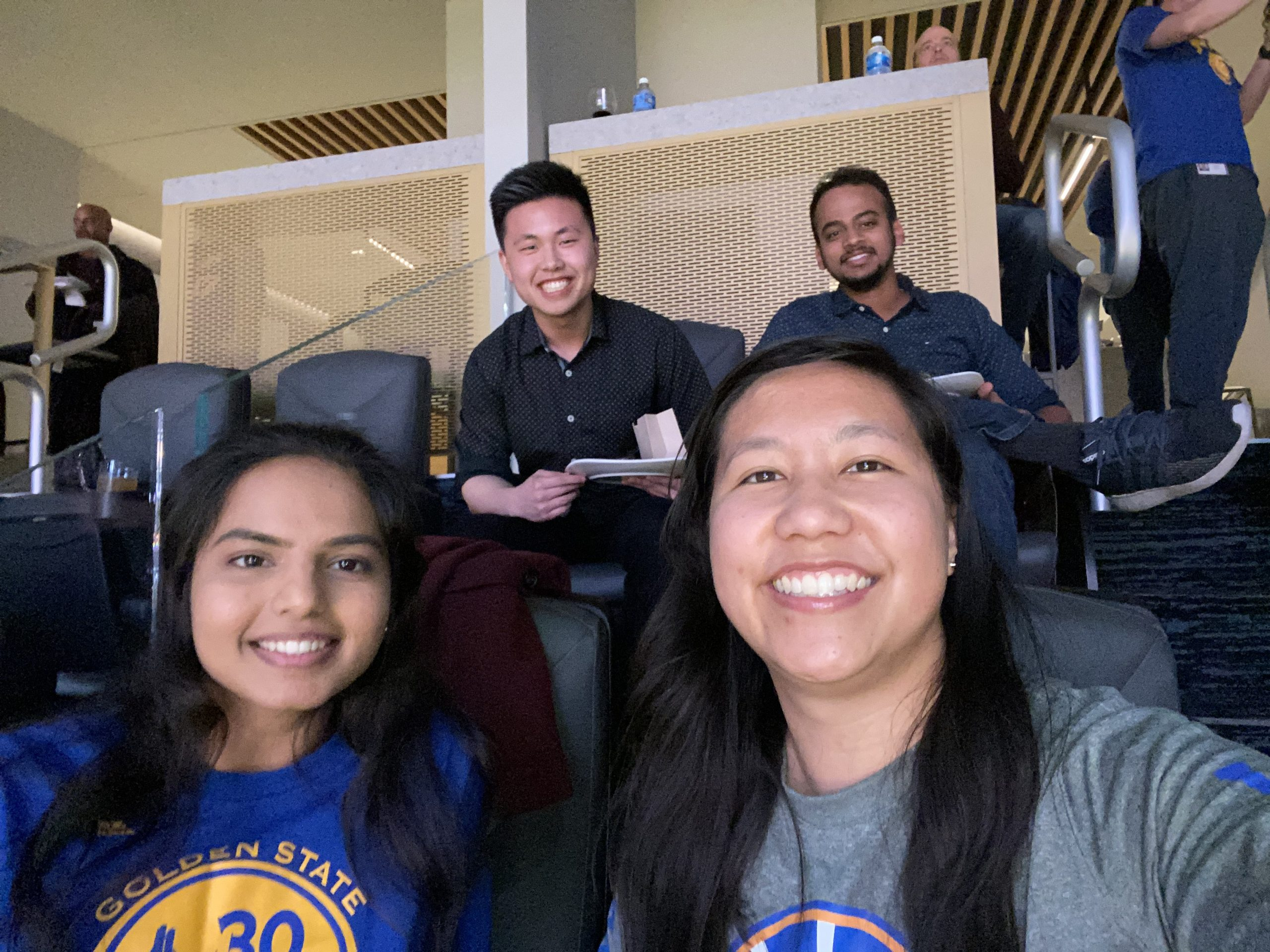 Selfie of four Cisco employees attending a Warriors basketball game.