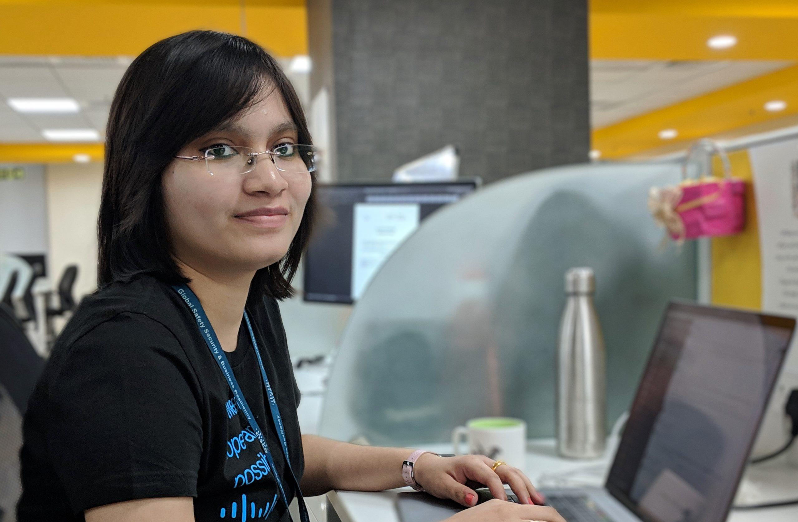 Trisha sitting at desk