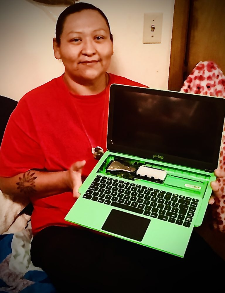 Tribal College student with a laptop