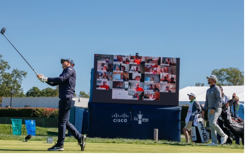 Man playing golf and onlookers looking with a Cisco Webex screen presenting the live footage