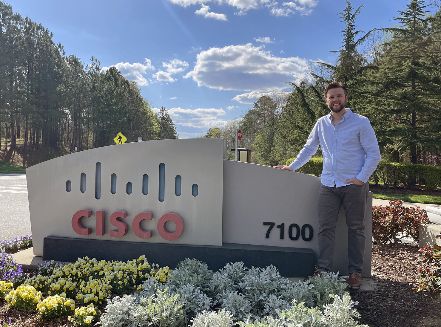 Stephen next to Cisco sign.
