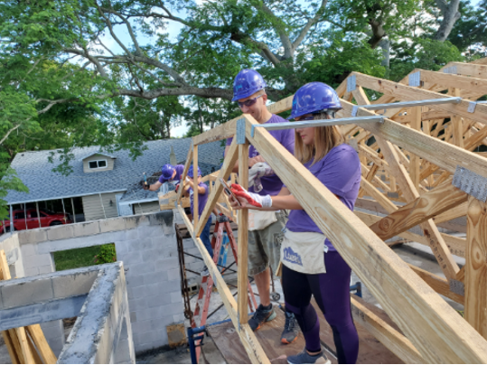 Cisco employees building a house together