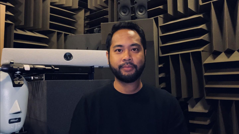 Josh in a studio recording room.