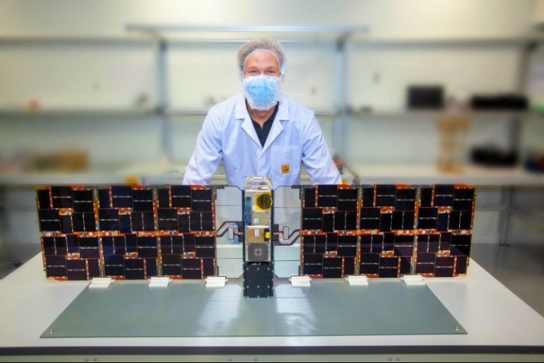 One of our nanosatellites with Fleet Space Engineer Kody Cook