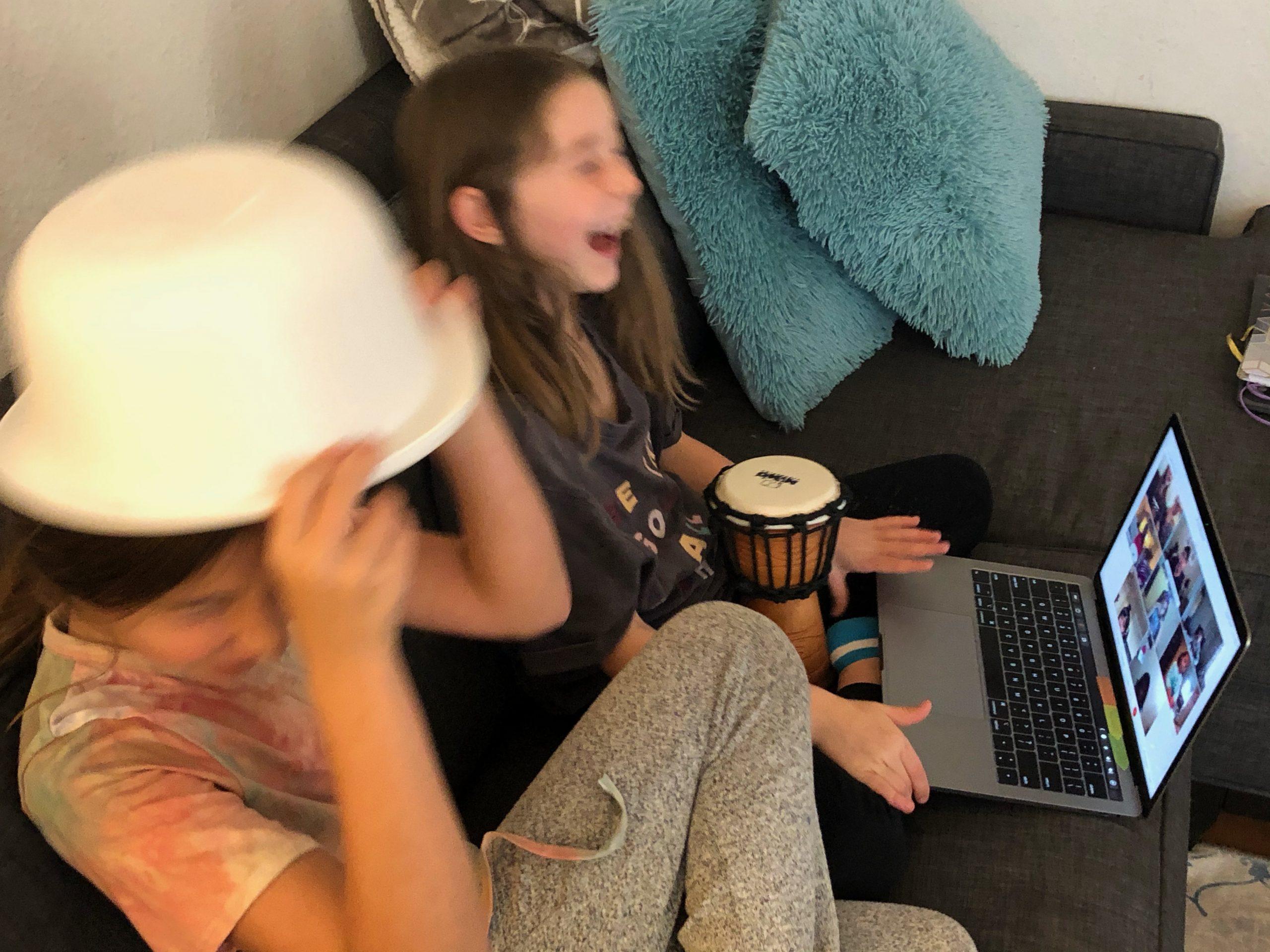 Kids enjoying remote online music class