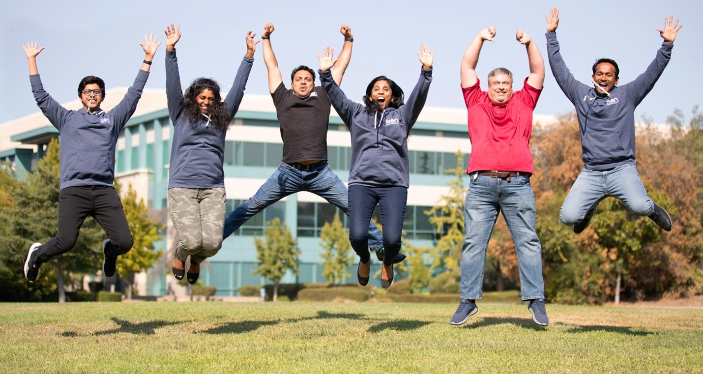 Sumant and his team jumping in front of the camera