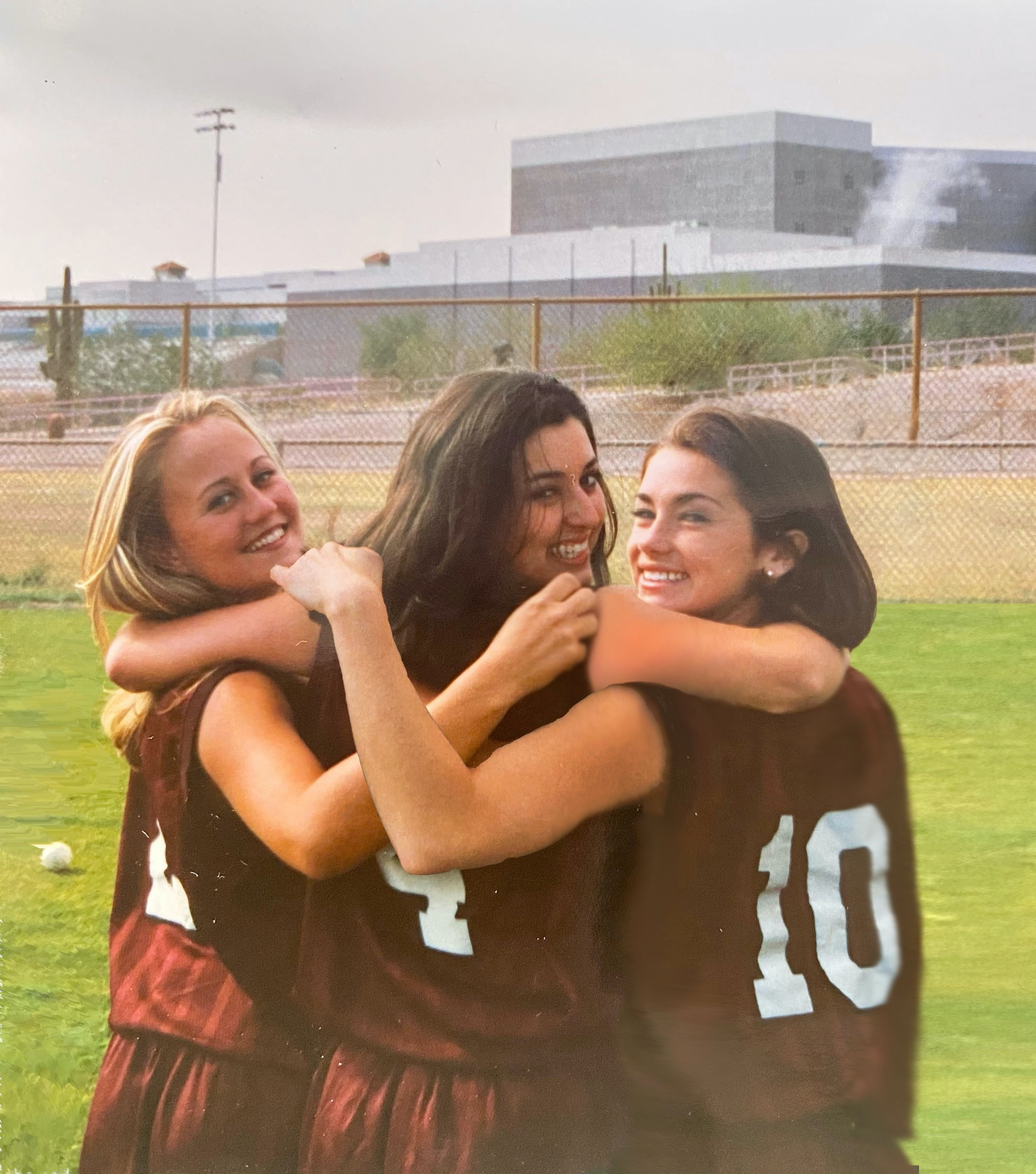 Kristen and her two friends on their old softball team.