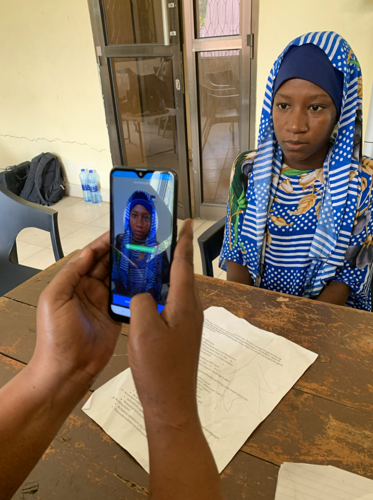 A woman being identified through facial recognition