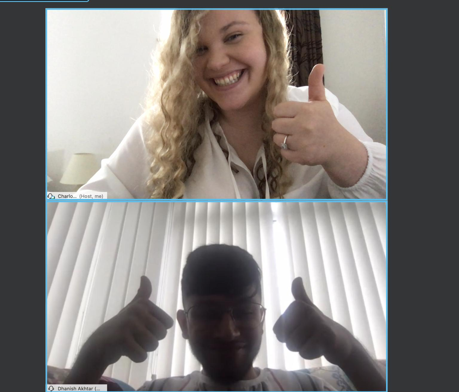 """Charlotte and a colleague give a """"thumbs up"""" over Webex."""
