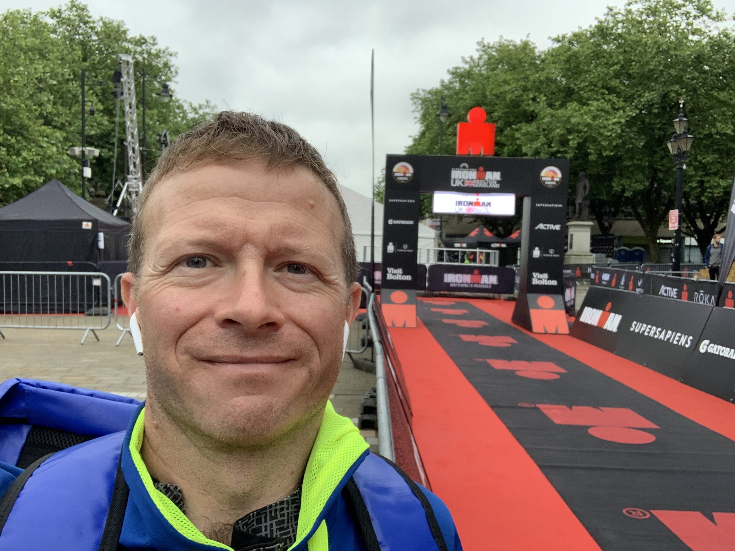 Mat taking a selfie in front of the Iron Man race finish line.