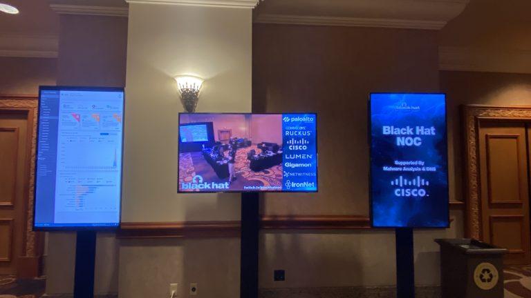 Monitors displaying sponsors at Black Hat