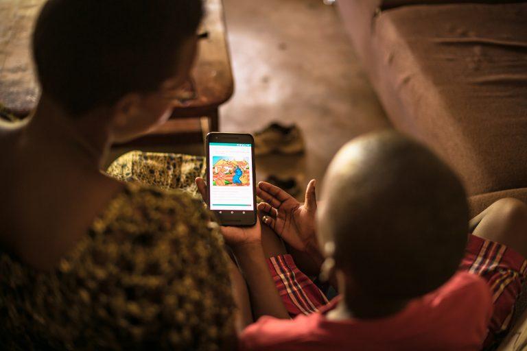 Parent reading to child through NABU's app