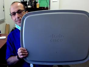 Shai Silberman, Director of Network Services at SJSU holding the Cisco Catalyst 9104 integrated stadium antenna
