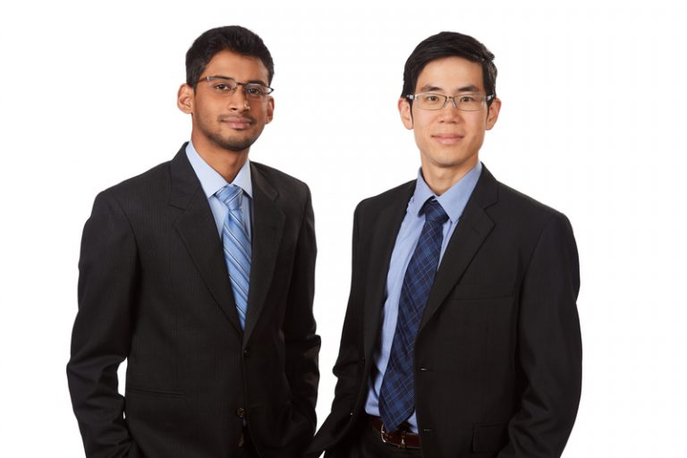 Two young men wearing business suits