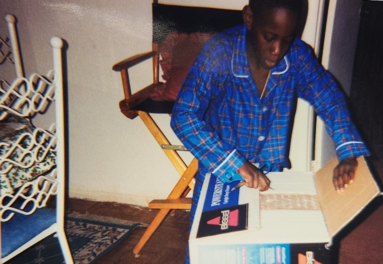 A young boy opening up a vacuum cleaner