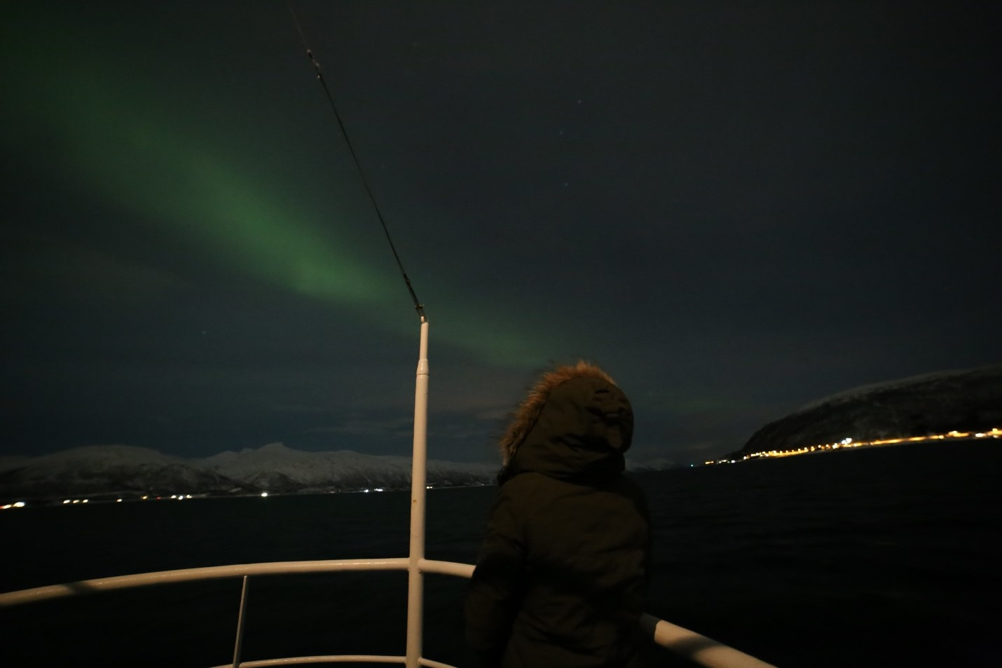 Miriam on a boat overlooking the Northern Lights.